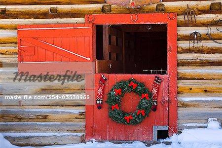 hanging on red barn door Christmas tree Arkans