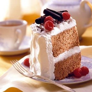 Valentine's Cocoa Angel Cake  Flavored with cocoa powder and generously frosted with sweetened whipped cream