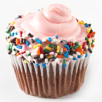 Box-mix makeovers  Roll the edge of a pink-frosted cupcake in multicolor sprinkles to add a Valentine touch to a box-mix treat.