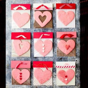 Creative cookie gifts  Package your Valentine's cookies in a simple, pretty homemade bag. Slip a cookie or two in a plastic treat bag (available at crafts stores) with a piece of scrapbooking paper. Fold contrasting paper over the opening, punch two holes, and tie with ribbon.