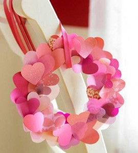 Heart wreath  Create a heart wreath with pretty card stock and scrapbooking papers. Use paper punches or scissors to cut out hearts, then curl by scraping them as you would curling ribbon. Layer and glue to a cardstock base.
