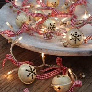 Oh so cute! Tie ribbon bows and jingle bells on white lights- TOO CUTE!