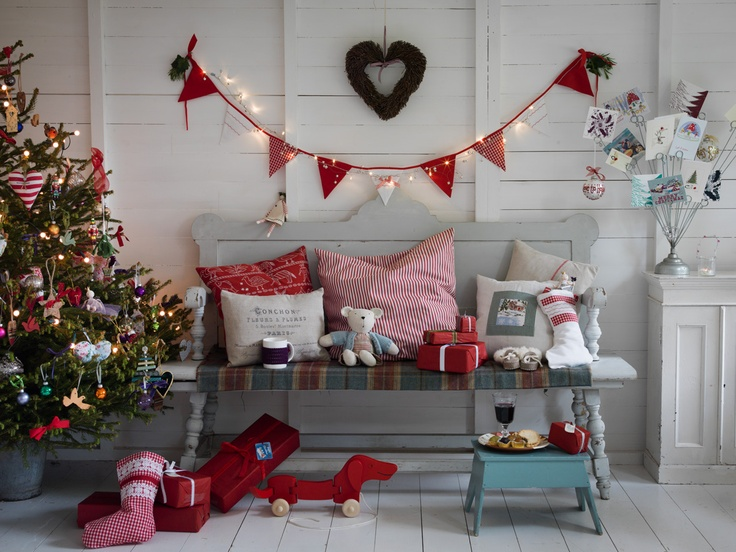 Lovely Christmas set up. Like the lights in the bunting. ♥ Country Living Christmas Fair – tickets in hand!
