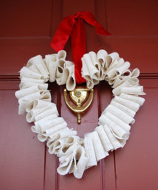 With a few spare minutes, a little wire, and some burlap ribbon, you can make this adorable heart-shaped wreath