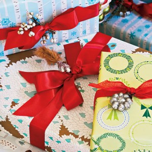 Adorn Your Gifts  Pretty up your presents by attaching bells or ornaments. Use the same color ribbon on all your packages under the Christmas tree to make a cohesive look with different patterned wrapping papers