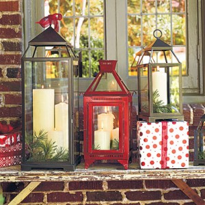Put Out Christmas Lanterns  Arrange a grouping of festive lanterns at your entryway for quick-and-easy holiday style. Consider using flameless candles as a worry-free alternative to regular pillars.