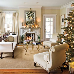 Decorate with Colors That Match Your Décor  Plan Christmas decorations to work with your existing decor, even if that means using unexpected colors like cream and beige. Accents in shades of gold and silver blend seamlessly with this room's soft white-and-ivory color scheme and play off the tones of other metallic accessories, like the coffee table.
