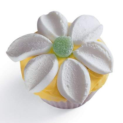 Flower Power Cupcake If you're ready for a thaw, encourage the spring blooms with these flower power cupcakes. They look so beautifl, no one will believe how easy they are to make.