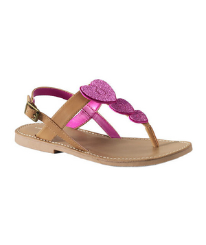 Phoebe Glitter Heart Sandals For the girly girl who loves to make a fashion statement: A pair of comfy slip-ons that prove hearts and sparkles are (and always shall be) a perfect match.