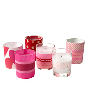 Mix and Match Votives  Give those scraps of paper headed to the recycling bin a second shot to shine. This idea works with all kinds of paper–even your kids' artwork.  What you need: Assorted paper, Washi Tape, Ribbon Double-sided Tape Votives  Wrap paper around votive for sizing; cut to necessary length. Adhere strips of paper to votive with double-sided tape. Be creative and have some fun. Wrap some with just paper and layer others with ribbon and tape.
