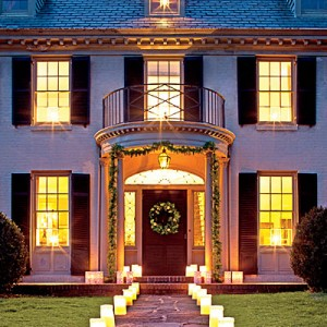 Create a Warm Welcome  Our favorite way to light up the season is with a brilliant array of paper luminaries. Line them along front walks, driveways, and porches for a fiery Christmas display that's so simple (and affordable) to pull off.