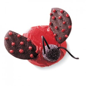 L is For Ladybug Cupcake This charming ladybug cupcake will fit right in at a party with a nature theme.