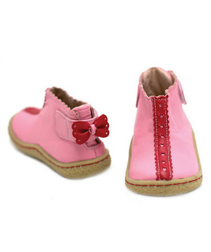 Lola Pink Boots Since booties are all the rage, these pink leather slip-ons will keep a hop in her step until spring.