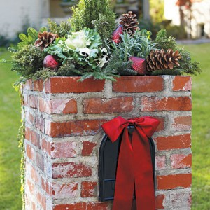 Merry Mailbox Topper  Top off a square mailbox with an abundant bouquet of winter plants. Fill a wide, shallow planter with a mix of pansies, flowering cabbage, cedar, fir, lavender, and rosemary trimmed to resemble a Christmas tree. Tuck in ornaments and oversize pinecones to add color and fill in gaps.