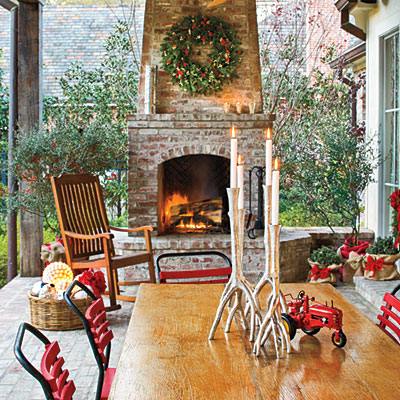 Add Cheer to Outdoor Spaces  Don't neglect outdoor patios and porches in your Christmas decorating. Wreaths, candles, and large glowing orbs draw guests outside to cozy up by the fire.