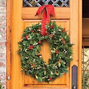 Stretch Your Wreath  Give your wreaths a custom look by stretching round ones to create an oval shape, perfect for double doors. Create a swag by attaching Christmas greenery to PVC pipe with wire, and suspend it above the door using wire secured to eye hooks screwed into the ceiling.