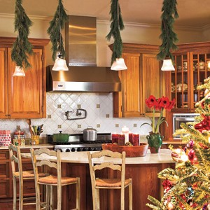 Decorate Pendant Lights  Dress up pendant lights in a kitchen or over an island with garland. This kitchen allows plenty of room for entertaining. The open floor plan keeps the cook from being cut off from the festivities on Christmas morning.