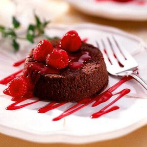 Softhearted Chocolate Cakes  A rich, soft center makes these chocolaty cakes irresistible. The Inn at Kristofer's in Sister Bay, Wisconsin, serves them with custard and raspberry sauces. We've simplified the recipe by calling for whipped cream and a fruit topping.