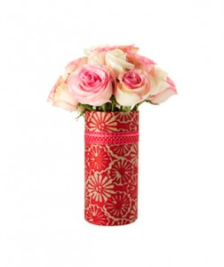 Decorative Flower Vase Same old pink stems? Not this year. This bunch of roses is arriving in a creative container.  What you need: Vessel Paper Double-Sided Tape Ribbon  Wrap paper around the vase and cut to necessary size. Adhere paper to vase with tape. Get creative and layer ribbon for an extra special touch. Then add flowers.