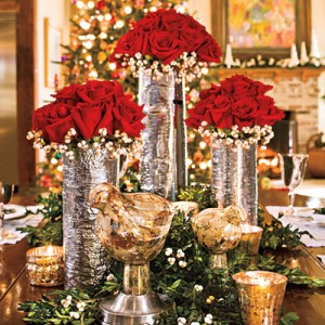 Create a Stunning Centerpiece  Create an elegant Christmas centerpiece with red roses surrounded by white tallow berries in silver vases made to resemble birch bark. Tuck pieces of boxwood garland and sprigs of berries around the base of the vases; add votives to finish the look.